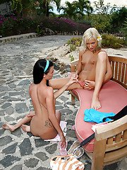 Graceful amateur lesbians fuck each other by a big strapon outdoor