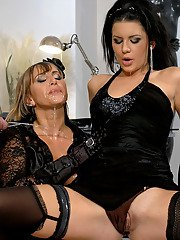 Lascivious fully clothed MILFs share a cock and get pissed on