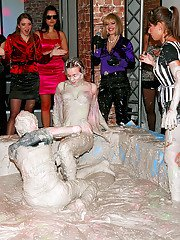 Alluring european fashionistas are into wild and messy mudwrestling