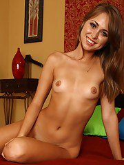 Cute teenage babe with tiny tits and shaved slit Riley Reid posing naked