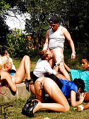Kinky gals sharing a hard cock and getting pissed on outdoor