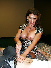 Lascivious mature brunette with big round jugs gives a handjob