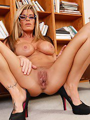 Busty MILF in glasses Kristal Summers stripping and teasing her pussy
