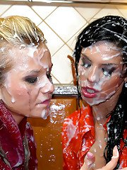 Lascivious fully clothed lesbians making some messy bukkake action