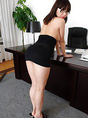 Naughty office lady in glasses Lara Page showcasing her tempting curves