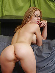 Naughty MILF in glasses Kora Peters stripping off her dress and panties