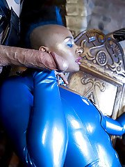 Ebony fetish lady in latex suit has a threesome with kinky guys