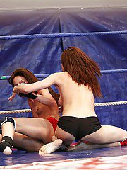 Horny lesbian wins a wild catfight and receives domination in strapon action