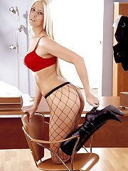 Bosomy blonde cutie in fishnet pantyhose stripping and toying her slit
