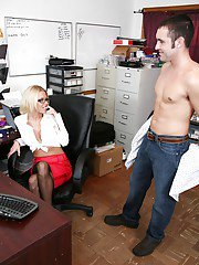 Slutty office babe gives a handjob and receives a large cumshot