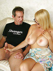 Big busted mature blonde in glasses receives a facial after a handjob