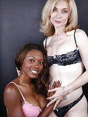 Mature blonde lesbian has some fun with her pretty ebony friend