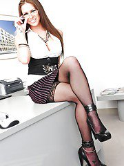 Ravishing office babe in stockings Hannah West revealing her big jugs
