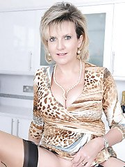 Mature vixen in nylon stockings revealing her big tits and shaved poon