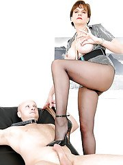 Naughty mature femdom on high heels torturing a swollen cock