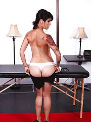 Tattooed MILF in glasses Dana Vespoli stripping off her suit and panties