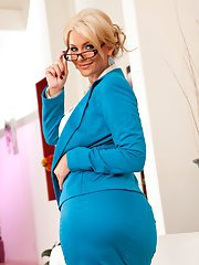 Ravishing MILF Phoenix Marie stripping off her suit and lingerie