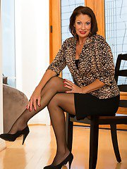 Lusty mature brunette Vanessa Videl stripping and spreading her legs
