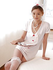 Tempting asian nurse in stockings Ray Ito stripping and taking shower