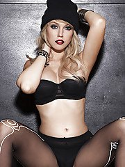 Tempting blonde babe Ashley Zeitler stripping off her top and pantyhose