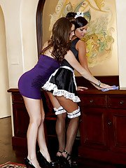 Horny lesbian Lily Carter making out with a slutty maid in stockings
