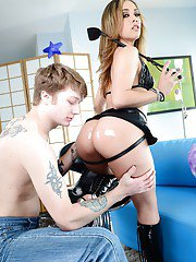 Kristina Rose poses wearing a strapon and lets a submissive guy suck it
