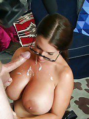 Mature bombshell in glasses gets her huge jugs covered with cum after handjob
