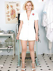 Filtny mature nurse with bushy cunt stripping and spreading her legs