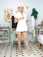 Horny mature lady in nurse uniform playing with gyno tools