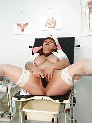 Naughty mature nurse stuffing her twat with a big dildo and gyno stuff