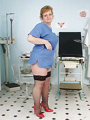 Fatty mature nurse in stockings masturbating her shaved cunt in gyno office