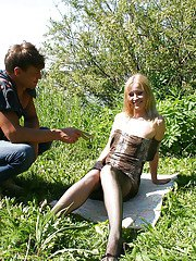 Horny blonde slut in ripped pantyhose gets banged by two guys outdoor