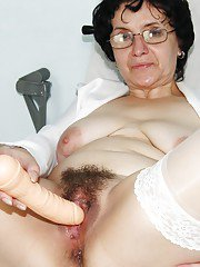 Kinky mature nurse stretching her twat with her fingers and toying it
