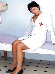 Naughty mature gyno nurse taking off her lingerie and exposing her twat