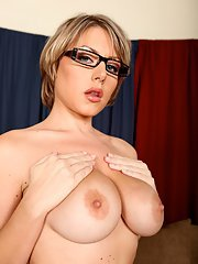 Sexy babe in glasses Velicity Von uncovering her big tits with hard nipples
