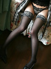 Tempting asian coed in stockings stripping and posing in lingerie