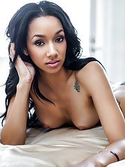 Pretty ebony babe Brittany Madisen uncovering her perfect body