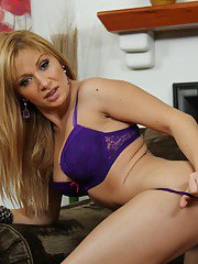 Bosomy lady Lea Lexis taking off her lingerie and spreading her legs