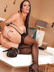 Mature vixen Vanilla Deville slipping off her dress and lingerie