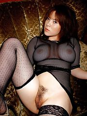Bosomy asian babe with hairy cunt posing in sheer outfit and stockings
