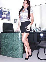 Leggy latina Ann Marie Rios slipping off her office suit and lingerie