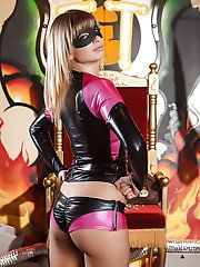 Seductive superhero Molly Bennett slipping off her latex outfit