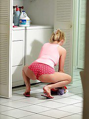 Trixie Star gets watched by a voyeur doing her household duties