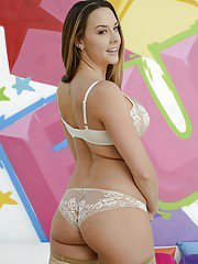 Voluptuous babe in stockings Chanel Preston slipping off her lingerie