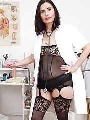 Bawdy mature nurse taking off her panties and exposing her pink twat