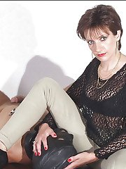 Lusty fetish lady in tights and high-heeled shoes face sitting her male pet