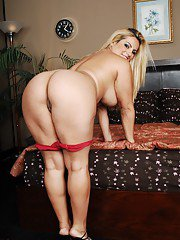Curvaceous blonde with massive cans and ample ass stripping off her clothes