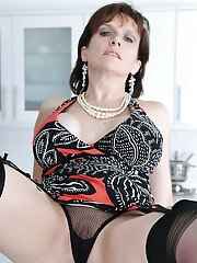 Saucy mature vixen in stockings rides a dildo after a panty play