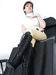Fully clothed mature fetish lady posing in high-heeled black boots