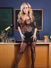 Lascivious teacher Amber Lynn gets rid of her skirt and pantyhose suit